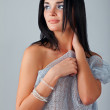 Portrait of a young brunette lady hiding her breast — Stock Photo #8885113