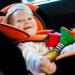 Stock Photo: Baby girl smile in car