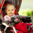 Baby in sitting stroller on nature — Stock Photo #8886774