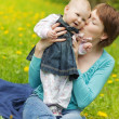 Young mother and looking at daughter outdoors - Foto Stock