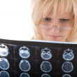 Female doctor looking at a tomogram — Stock Photo #8887180