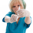 Doctor holding a syringe in his hand - Stock Photo