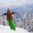 Snowboarder on the mountain with his arms raised — Stock Photo