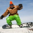 Snowboarder jumping through air with deep blue sky in background — Stock Photo #8888514