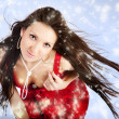 Sexy mrs. Santa posing on blue winter background with snowflakes — Stok fotoğraf