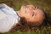 Relaxing girl on meadow — Stock Photo