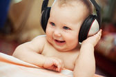 Smiling baby with headphone — Stock Photo