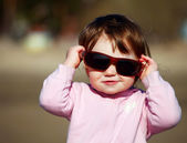 The portrait of a little girl in sunglasses — Stock Photo