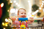 Beautiful baby girl in shopping cart - trolley — Stock Photo