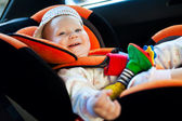 Baby girl smile in car — Stock Photo