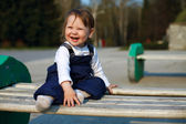 Portrait of happy baby girl in park — Stock Photo