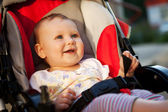 Baby in sitting stroller on nature — Stock Photo