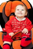 Baby girl smile in car — Stock Photo