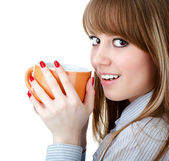 Young woman with a cup of hot drink on the white — Stock Photo