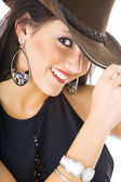 Super sexy rodeo cowgirl in jeans and a cowboy hat isolated — Stock Photo