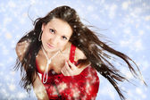 Sexy mrs. Santa posing on blue winter background with snowflakes — Stock Photo