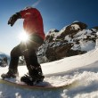 Snowboarder doing a toe side carve with deep blue sky in background — Stock Photo #8912157