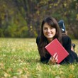 Young girl reading a book — Stock Photo #8913618