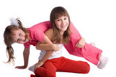Happy smiling little sisters on white background — Stock Photo