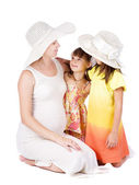Mother and daughters on the white — Stock Photo