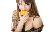 Advertising picture of beautiful woman with orange — Stock Photo