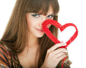 Young blond with a red knit heart — Stok fotoğraf