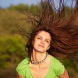 Young woman with hair flying outdoor — Stock Photo