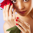 Studio portrait of sensual beautiful woman with rose — Stock Photo