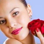 Studio portrait of sensual beautiful woman with rose — Stock Photo