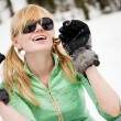 Young snowboarder reaches his arms on the snow - Stock Photo