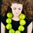 Stock Photo: Young beauty woman with apple on grey background