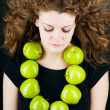 Young beauty woman with apple on grey background — Stock Photo