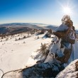 Ski slope and panorama of winter mountains. — Stock Photo