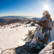 Ski slope and panorama of winter mountains. - Stock Photo