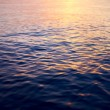 Picture of the surface water in the sunset time - Stock Photo