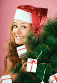 A beautiful young attractive girl in a charming hat of Santa Claus — Stock Photo