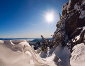 Ski slope and panorama of winter mountains. — Foto Stock