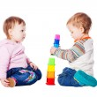 Two babies playing with toy isolated — Stock Photo