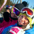 Royalty-Free Stock Photo: Snowboarders on the chairlift smile for the camera