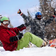 Happy snowboarding team in winter mountains — Stock Photo