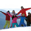 Stock Photo: Happy snowboarding team in winter mountains
