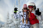 Young happy smiling girls on mountain — Stock Photo