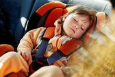 Baby girl in car — Stock Photo