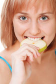 Close up pretty young woman holding an apple — Stock Photo