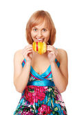 Portrait of happy young woman holding mixed fruits — Stock Photo