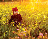Happy girl with field flowers — Stock Photo