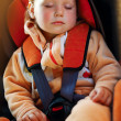 Baby girl  in car - Stockfoto