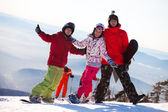 Happy snowboarding team — Stock Photo