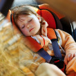 Baby girl  in car - Stock Photo