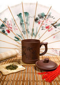 Tea still-life with Chinese can — Stock Photo